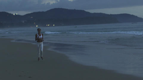 Sportive Runner Running On The Beach At Sunset Footage