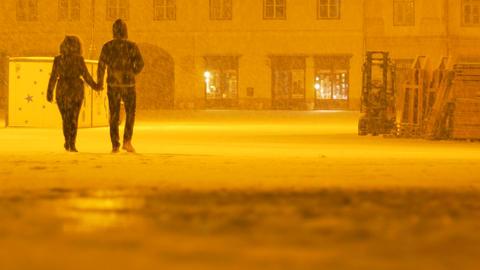 Couple Walking on Snowy Night Footage