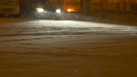 Night Deposited Snowing on Street Footage