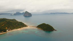 The beautiful bay with mountains rocks aerial view. Tropical islands Footage