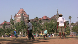 Playing cricket in front of Bombay University Stock Video Footage
