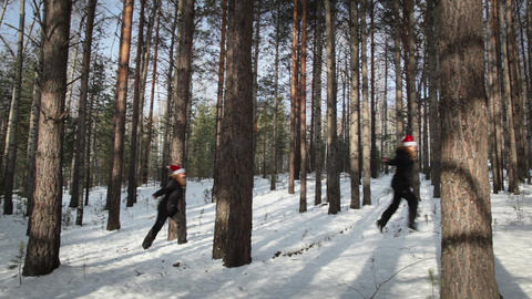 Women in cap Santa Claus walking in the woods Footage