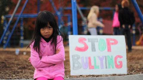 Angry Asian Girl With Stop Bullying Sign At School Footage