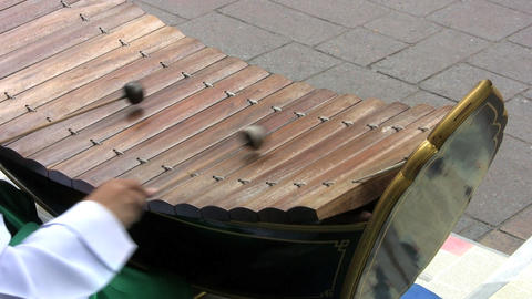 Asian Boy Playing A Wooden Xylophone Stock Video Footage