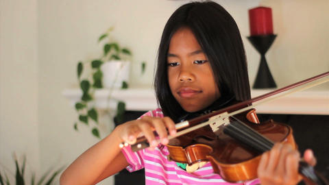 Asian Girl Practising Violin Stock Video Footage