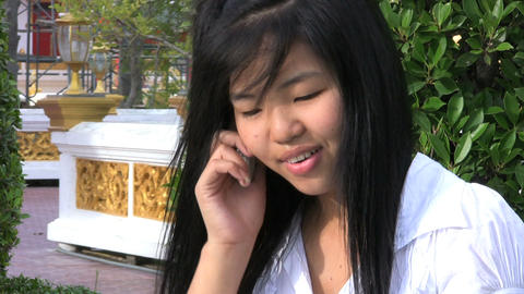 Asian Girl Talking On Her Cell Phone Footage
