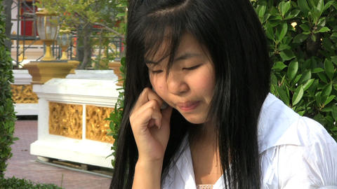 Asian Girl Talking On Her Cell Phone Stock Video Footage