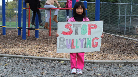 Asian Girl With Stop Bullying Sign Stock Video Footage