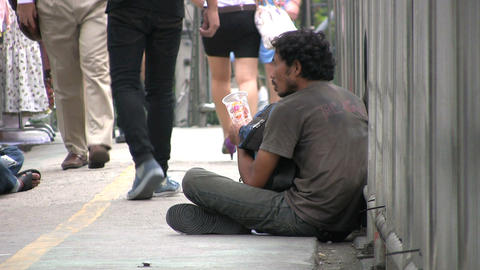 Beggar On Walkway Stock Video Footage