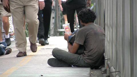 Beggar On Walkway Footage