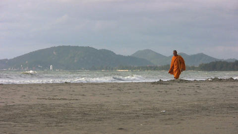 Buddhist Monk Walks Down The Beach Footage