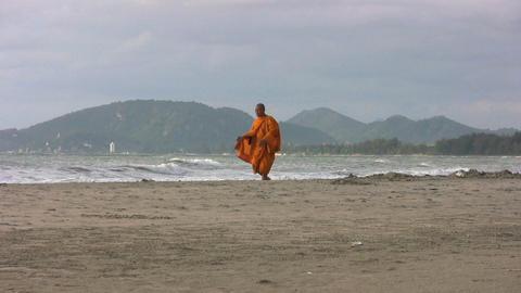 Buddhist Monk Walks Down The Beach Stock Video Footage