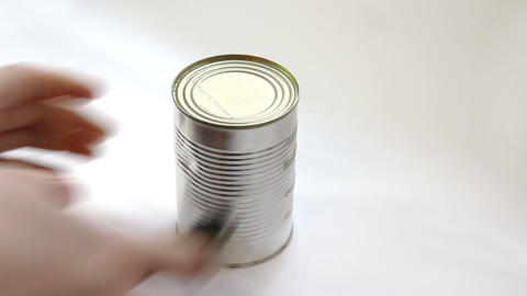Man opening metal can with tomato sauce with vintage key Stock Video Footage