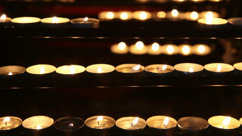 Burning candles in the St. Stephan cathedral, Vienna, Austria Footage
