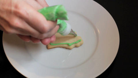 Decorating Bell Shaped Christmas Cookie Footage