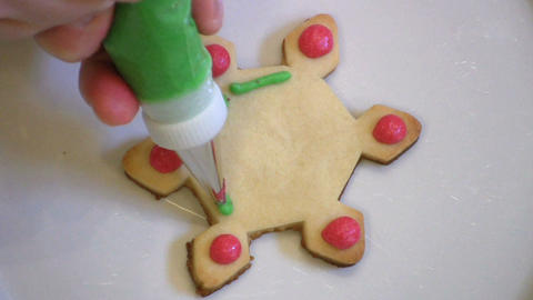 Decorating Christmas Snowflake Cookie Footage