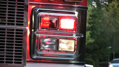 Flashing Lights On Firetruck With Traffic Stock Video Footage