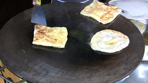 Frying Roti Canai Bread Stock Video Footage