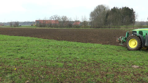 Ploughing farmland with tractor and plough Stock Video Footage