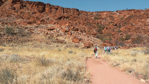tourists walk in front of table mountain at twyfelfontein,namibia,africa Footage