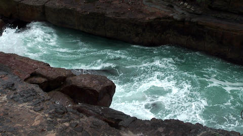 water streaming into blowhole Stock Video Footage