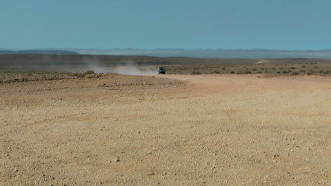 4WD car driving trough the namibian desert Stock Video Footage