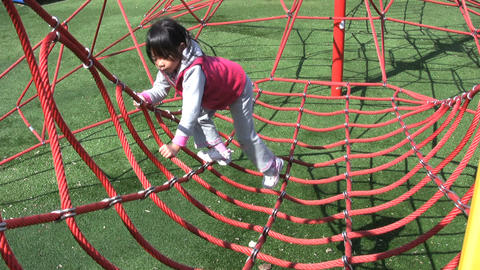 Girl Climbing Sky Net At Playground Footage