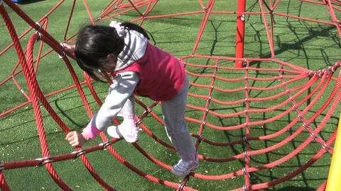 Girl Climbing Sky Net At Playground Stock Video Footage