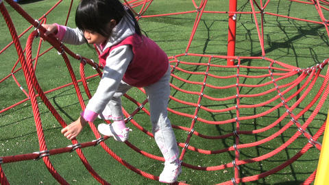 Girl Climbing Sky Net At Playground Stock Video Footage