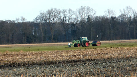farm tractor with roller flattening land Stock Video Footage