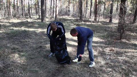 Volunteer removes debris Stock Video Footage