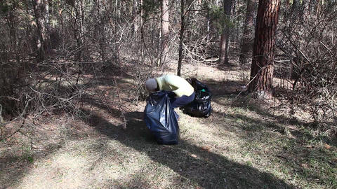 Volunteer removes debris Footage