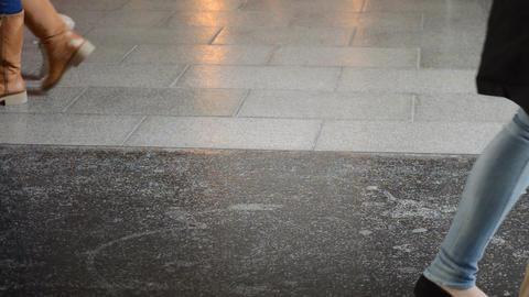 People Walking On Shiny Floor Footage