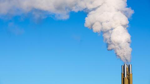 White smoke rising from smokestacks ビデオ