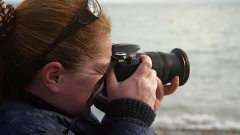 female Photographer Shooting landscape Footage