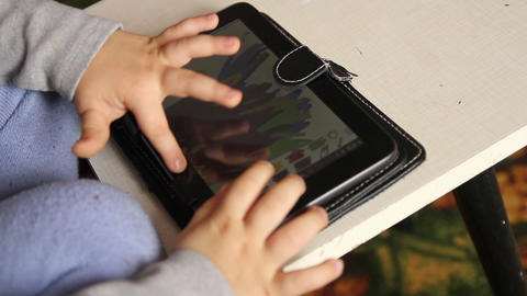 baby finger play with tablet touchscreen Live Action