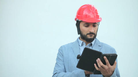 man in construction helmet make calculations Live Action