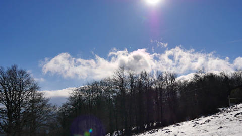 Fast moving clouds, view from mountain during winter time Footage