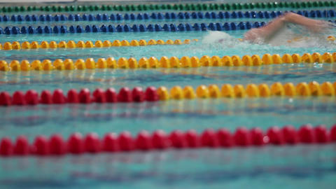 Swimmer close to tracking shot Footage