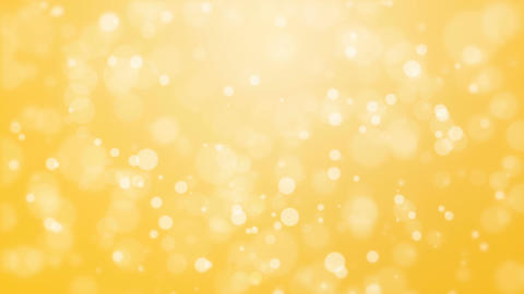 Glowing yellow background with light particles Animation