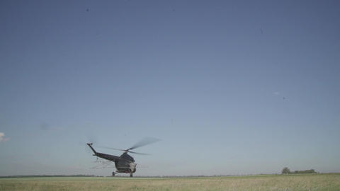 Agriculture Helicopter Flies Over the Field Footage