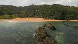 Seascape with tropical island, beach, rocks and waves. Catanduanes, Philippines Footage