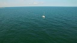 Aerial flight over sailboat at sea Footage