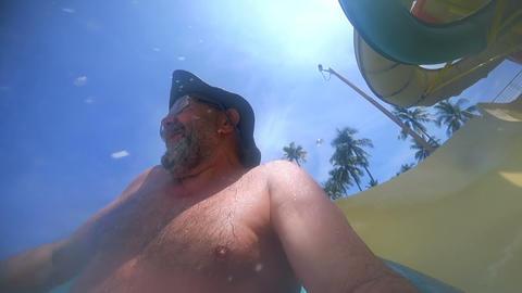 Senior man riding in aquapark tube Footage