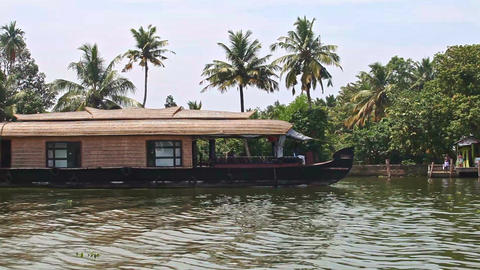 Floating House Sails along Wide River by Palms in Tropics Footage