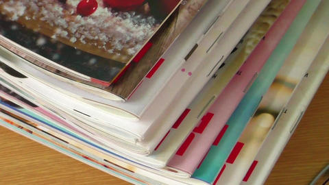 Magazines on table with eyeglasses Footage
