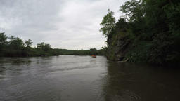Summer view from floating boat on muddy river in overcast weather Footage