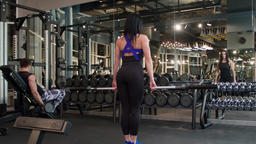 Fitness peoples doing exercise 4k gym video. Woman deadlift with barbells Footage