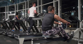 Fitness people cardio training in gym 4k video. Men woman runs walks treadmill Footage