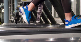 Close-up running legs foots on treadmill machine gym 4k video. Jogging training Footage
